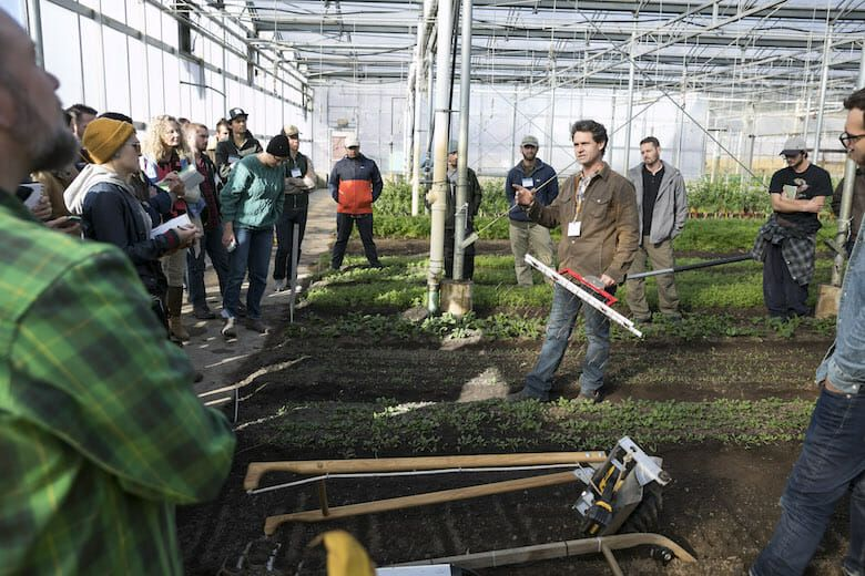 Picture of a group of men and women in a greenhouse