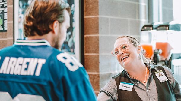 First & Goal employee assisting Seahawks fan