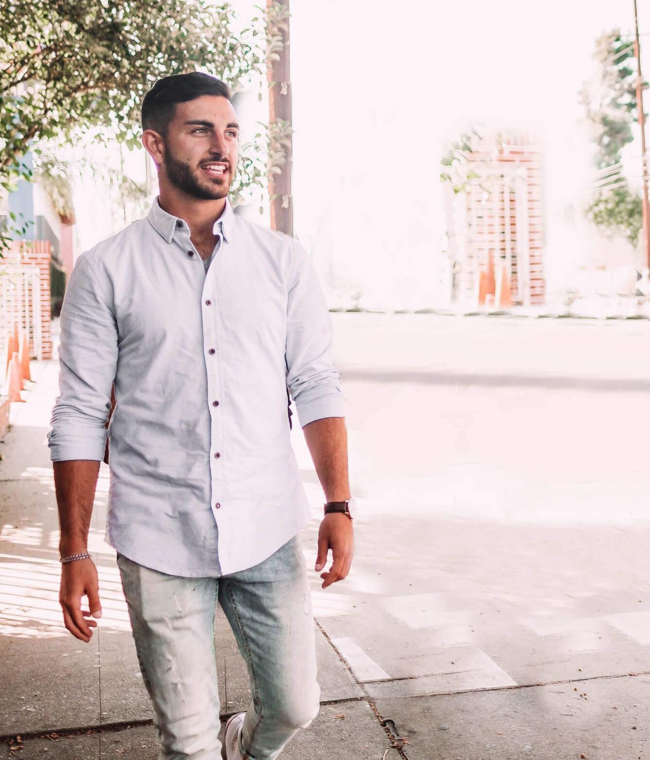 Shot of Zack Honarvar walking on street.