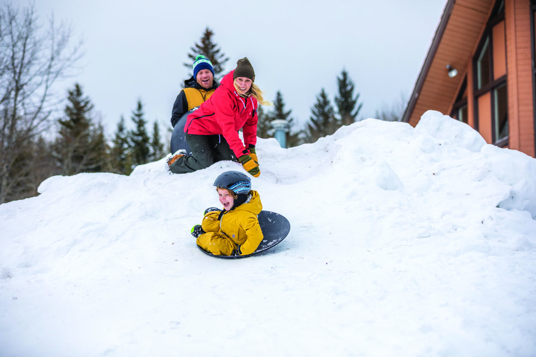 A family plays in the snow at Cypress Hills Interprovincial Park.