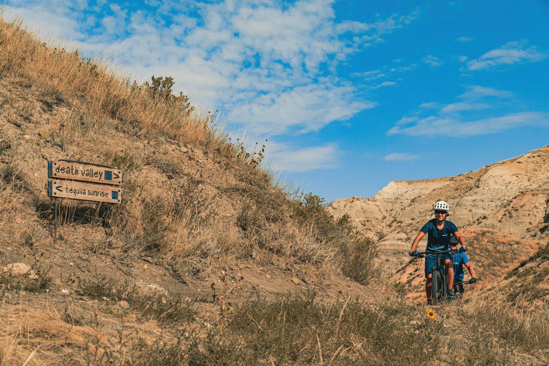 A biker rides through the bike trail along the South Saskatchewan River in Medicine Hat.