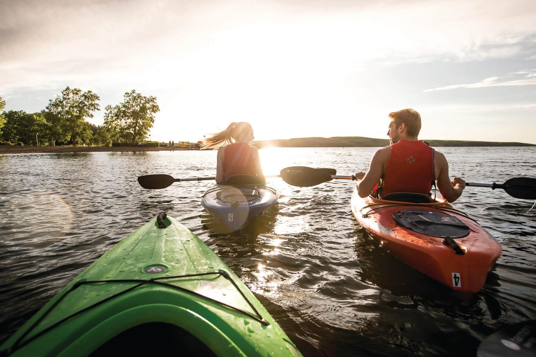 Kayakers at sunset on the lake at Cypress Hills Interprovincial Park.