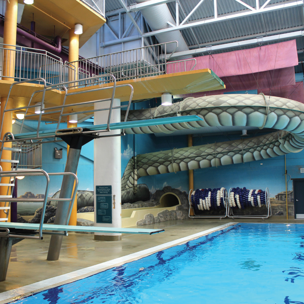 Medicine Hat Family Leisure Centre olympic sized pool, high board, and waterslide.