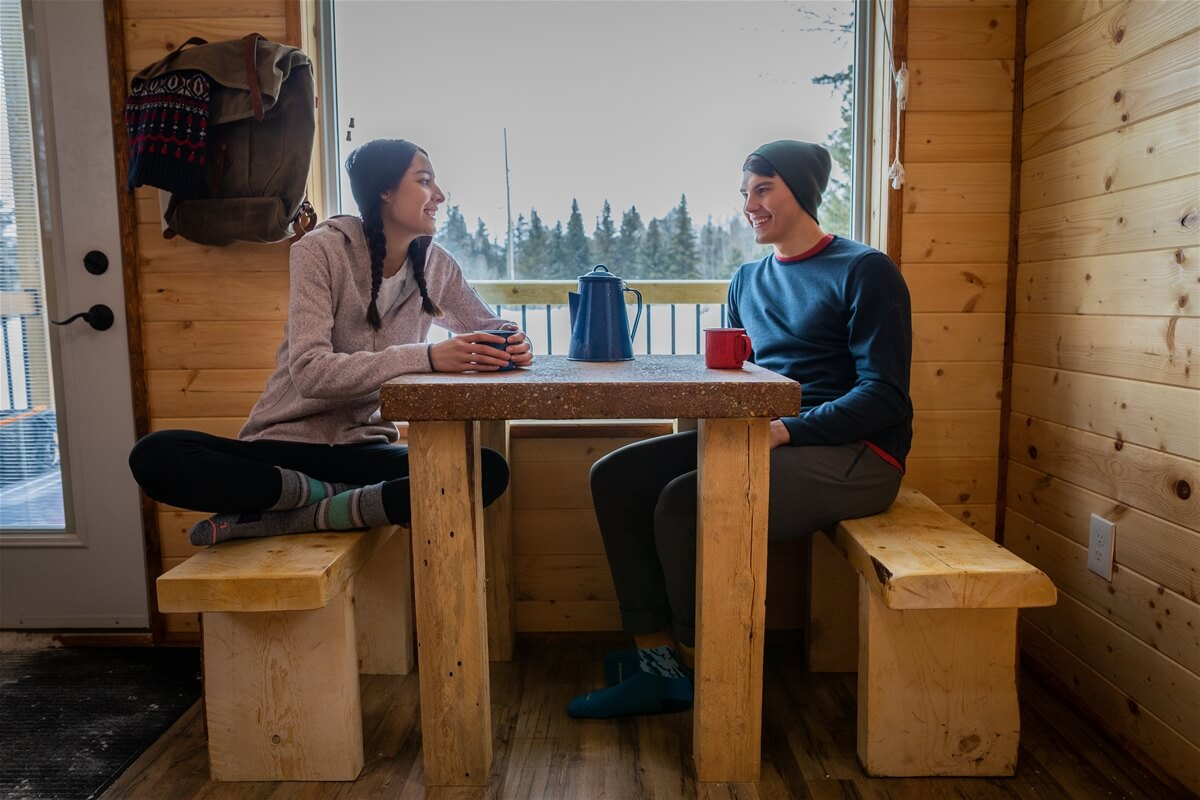 A couple sits at a table in a cozy cafe at Cypress Hills Interprovincial Park.