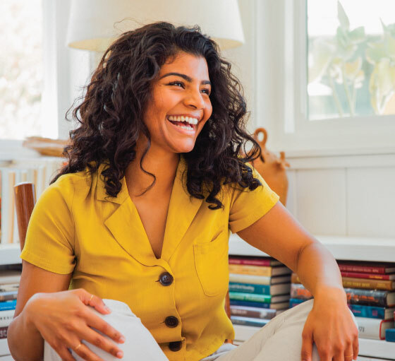 Lifestyle photo of woman sitting and smiling