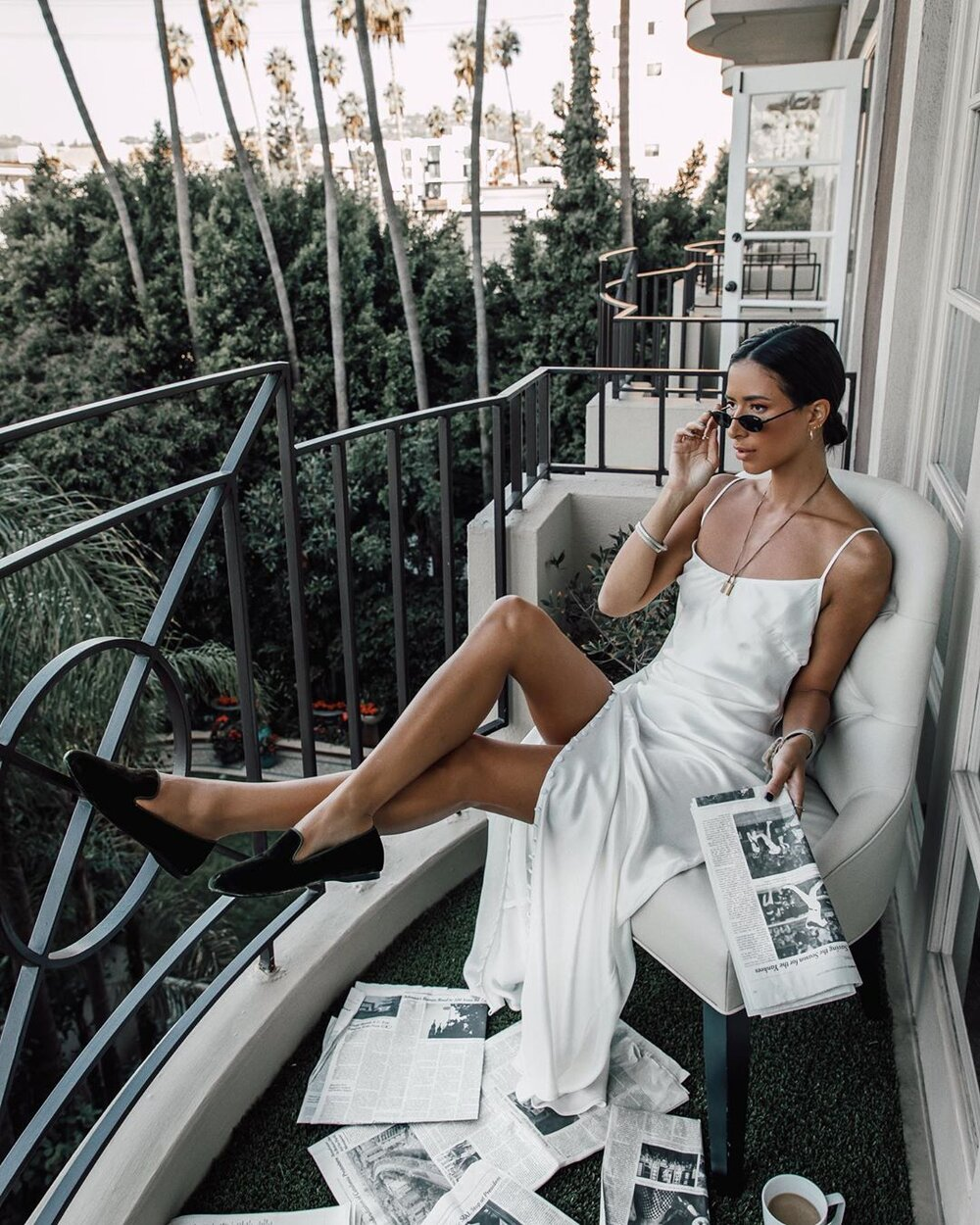 Lady sitting on a balcony