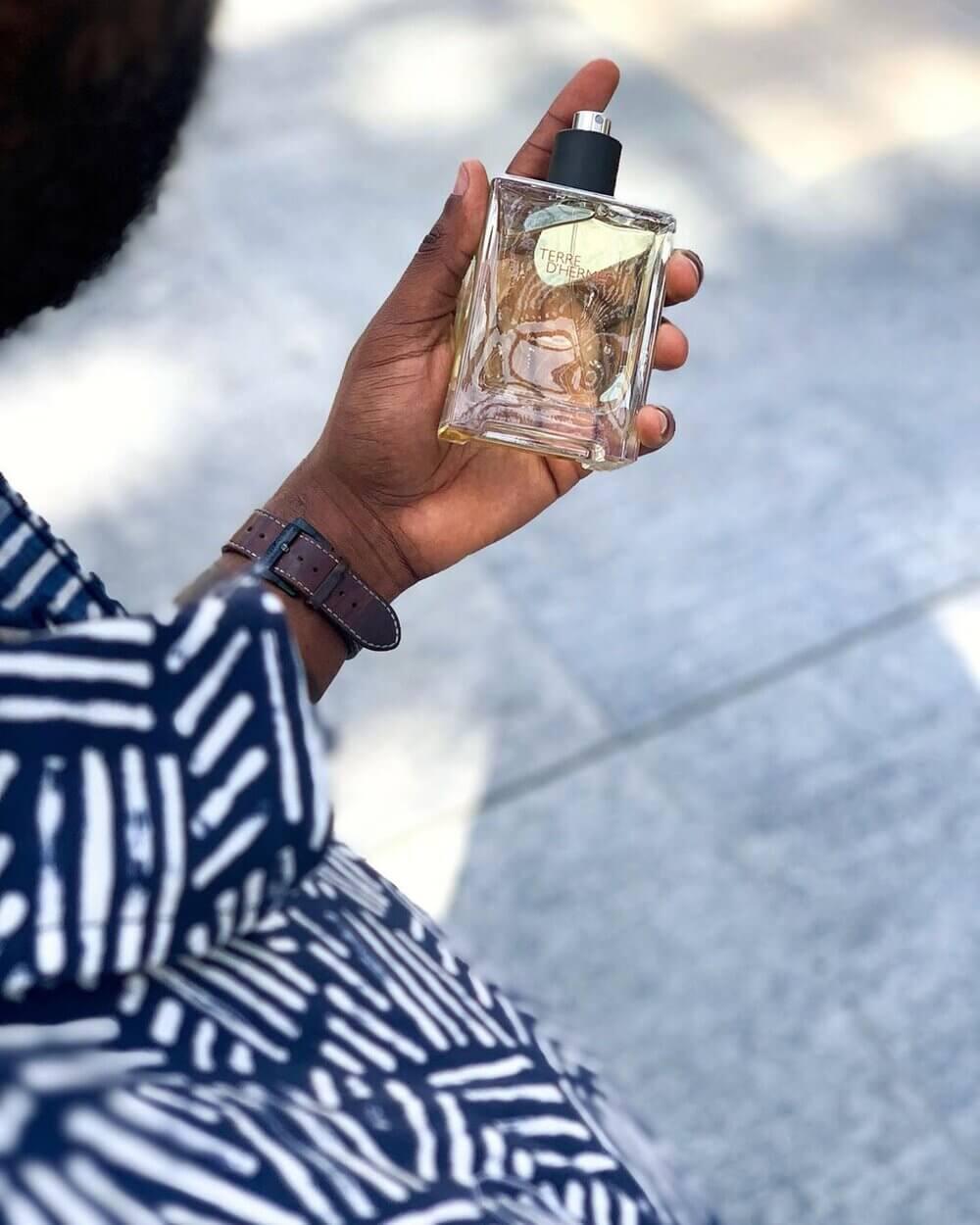 hand holding perfume