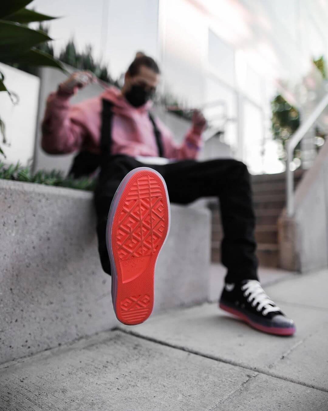 foot kicking toward camera