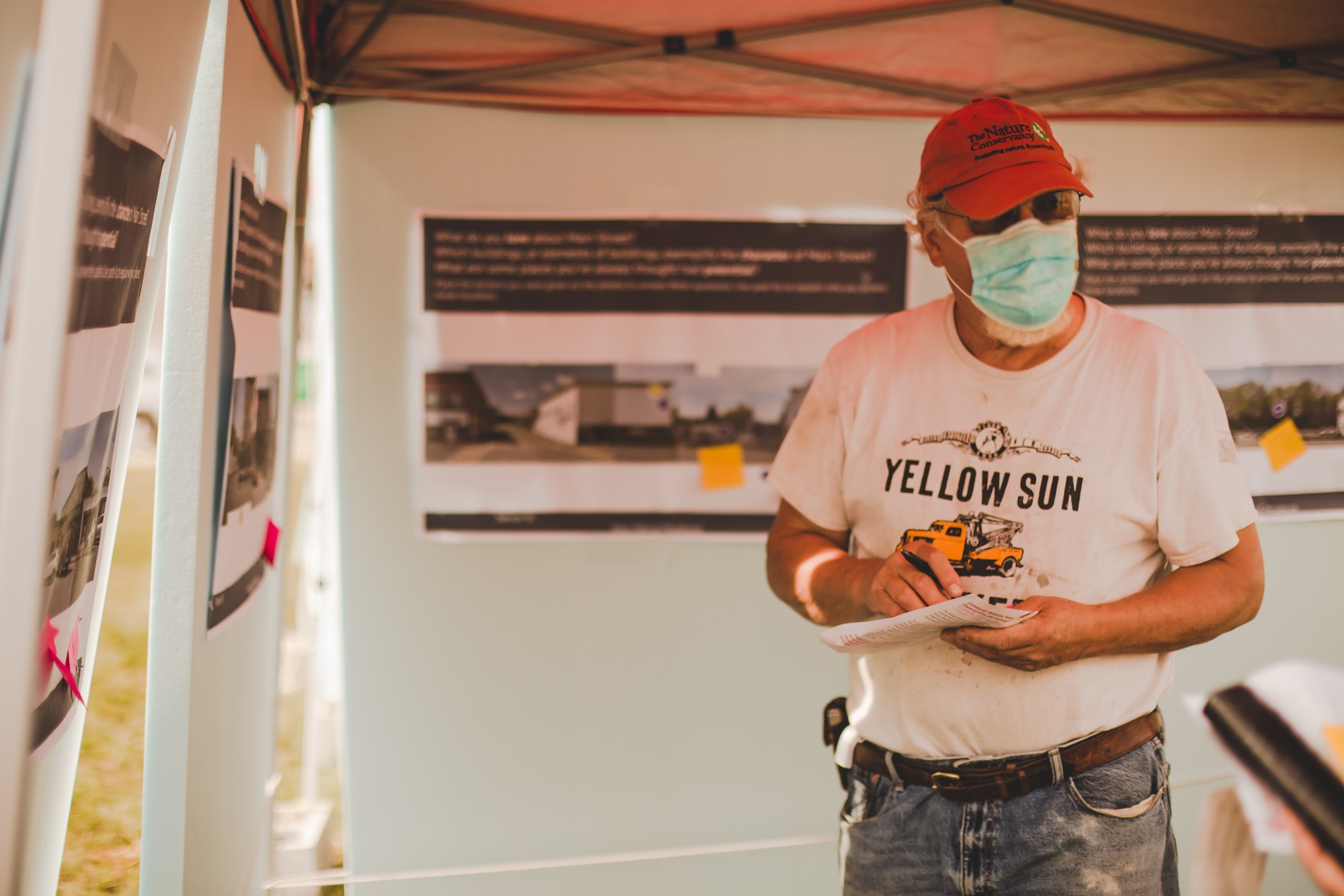 Millinocket resident engages with images of the downtown corridor PC: Malorrie Ann Photography