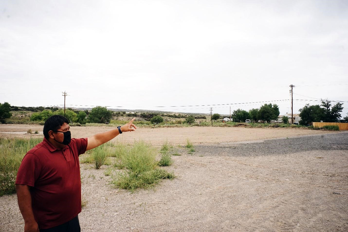 Pueblo of Laguna planner Elroy Keetso shows the empty site to the design team. Photo by Omar Hakeem, courtesy To Be Done Studio.
