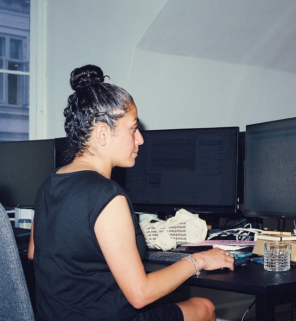 Employee working at her desk