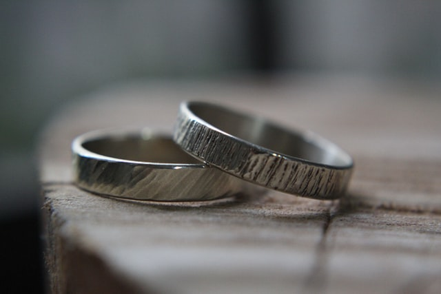 2 silver rings on a table