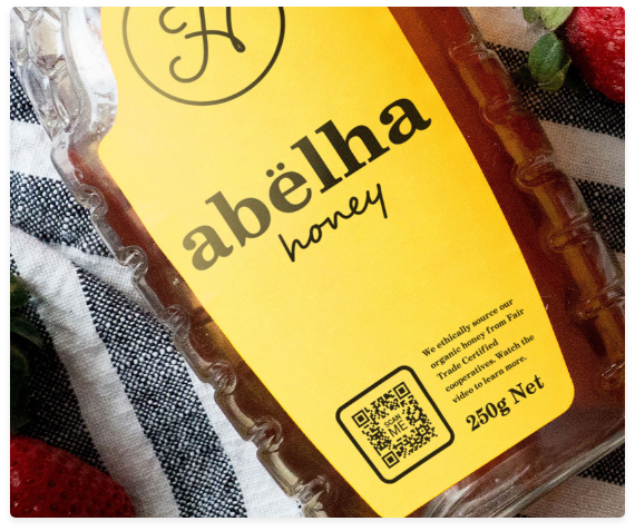 QR code on bottle of honey with clear call to action