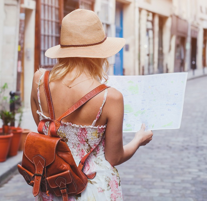 Travel - Woman reading map