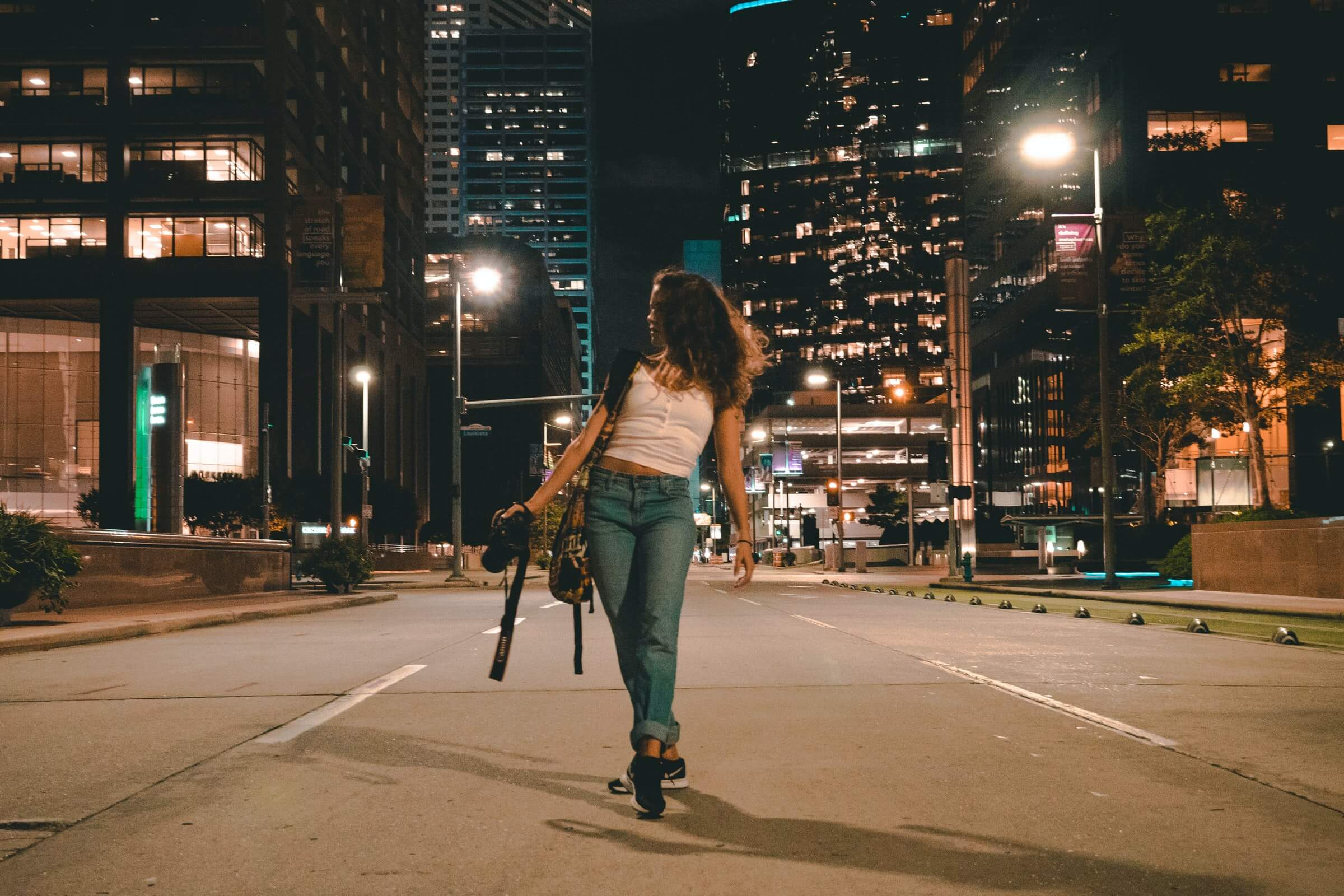 """Girls walks down the empty streets of Houston, illustrating the population loss outlined in Unacast's white paper, """"Houston's billion dollar break up"""""""