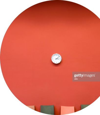Small clock on a red wall