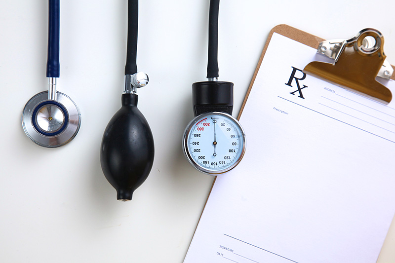 A grouped medical image of stethoscope, blood pressure gauge and clipboard.