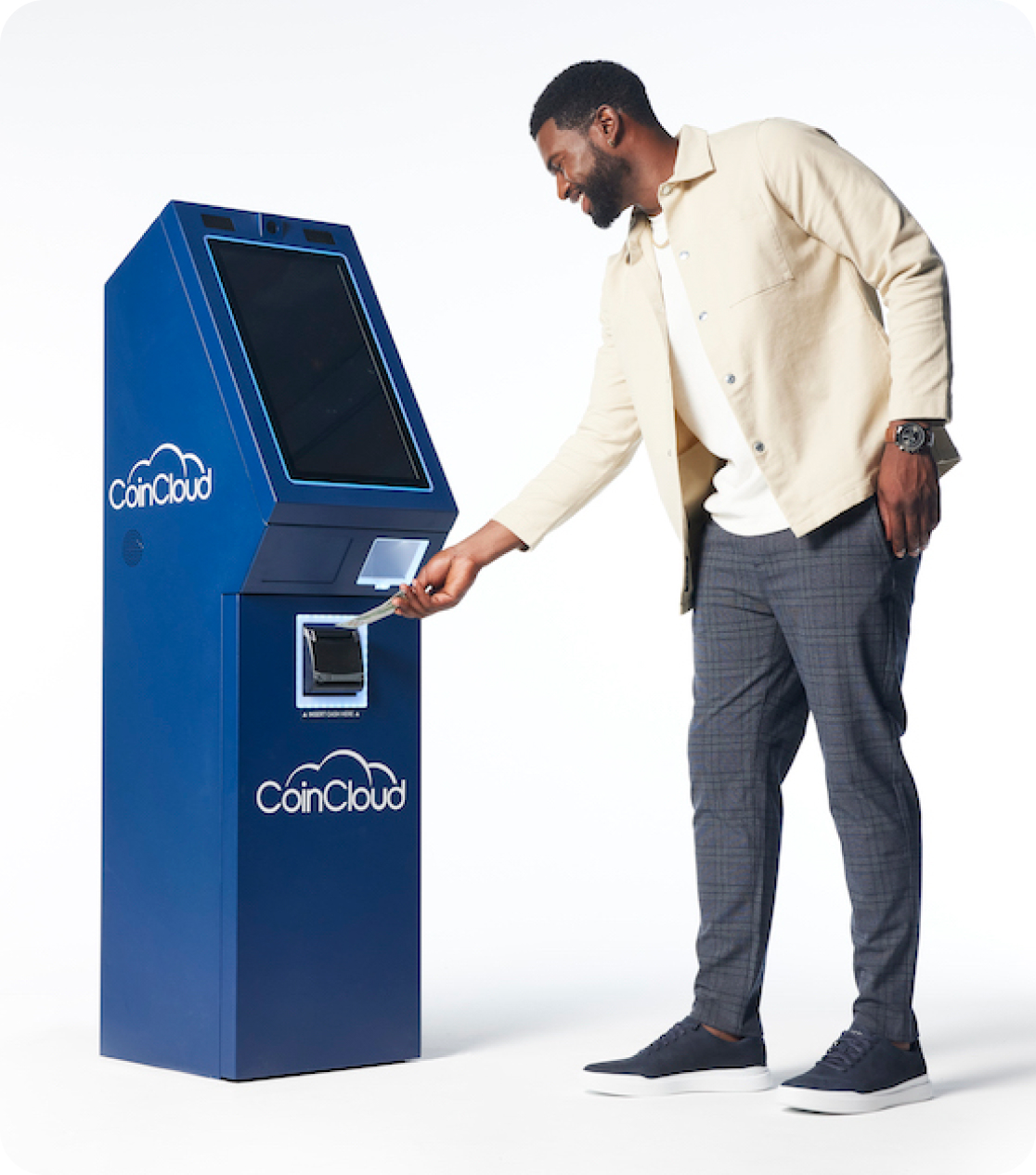 Man feeding money into a Coin Cloud digital currency machine kiosk