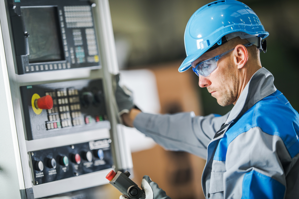 A picture of a person operating a machine that is being monitored