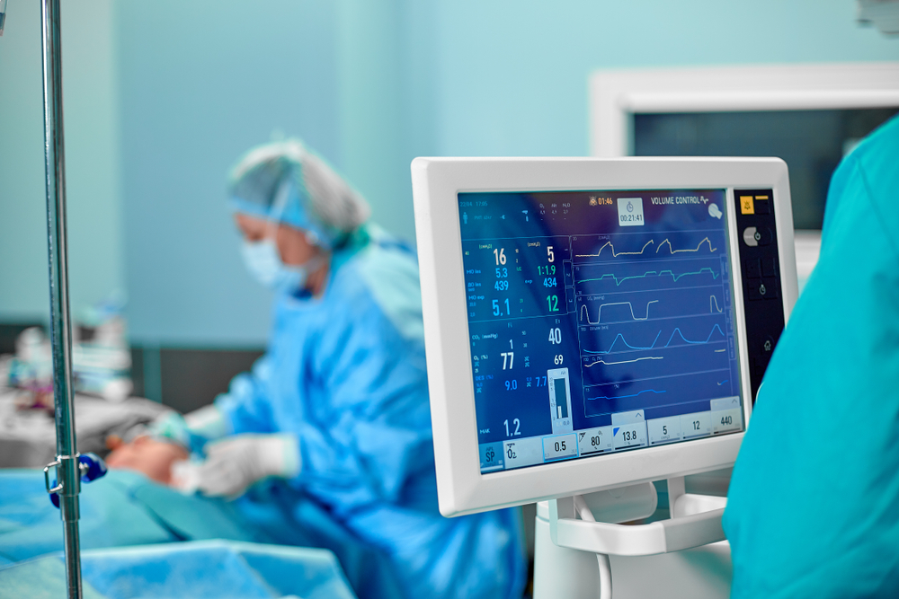 A picture of a patient being monitored in an operating room