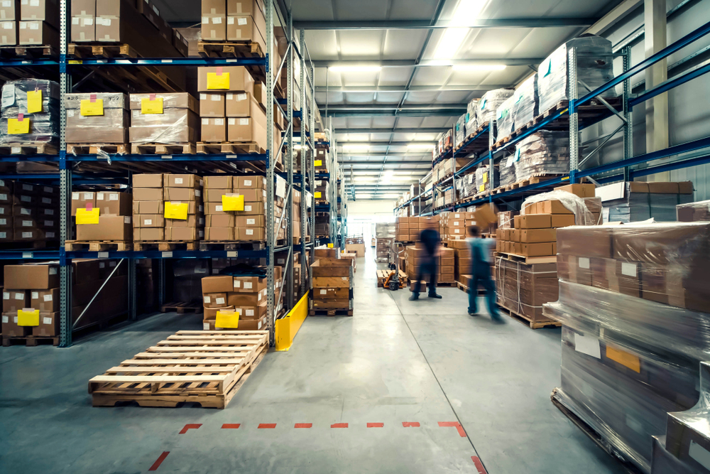 A picture of a warehouse with boxes and pallets that can be tracked