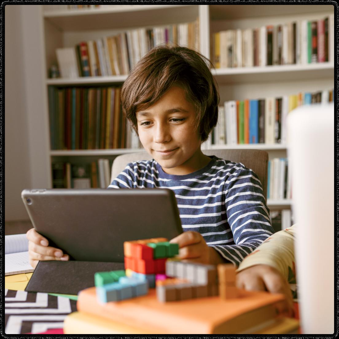Boy on iPad - Tutoring