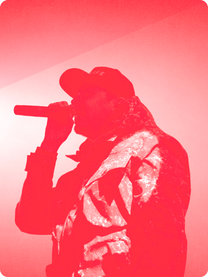 Silhouette image of man rapping into a microphone
