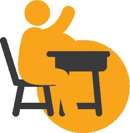 A student raising their hand at a desk.