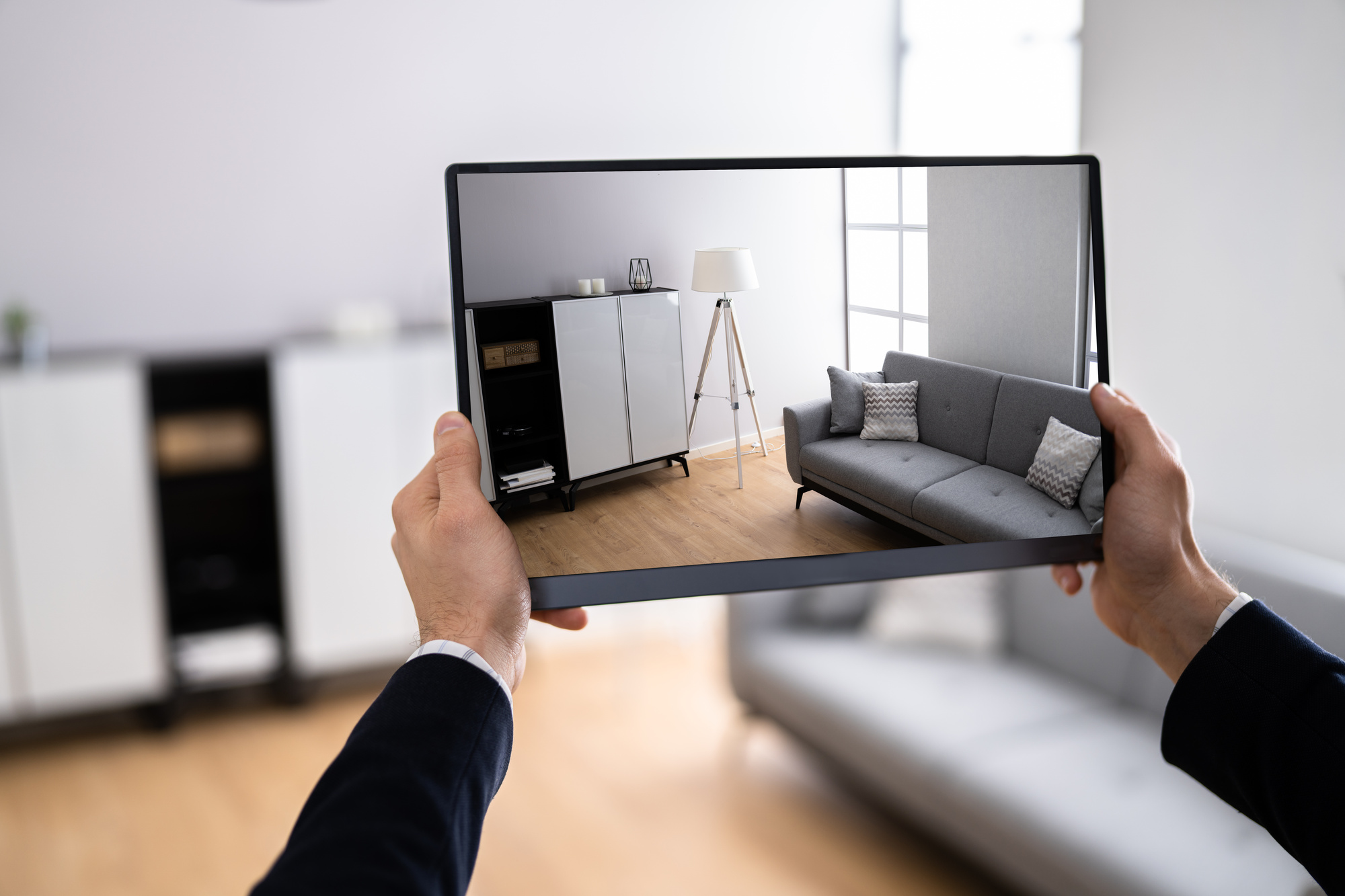 a person taking a photo with their tablet