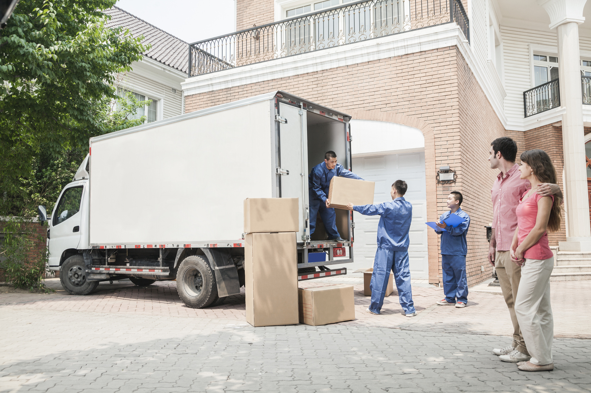 people moving boxes out of a truck