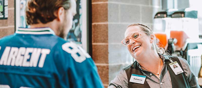 Staff interacting with guest
