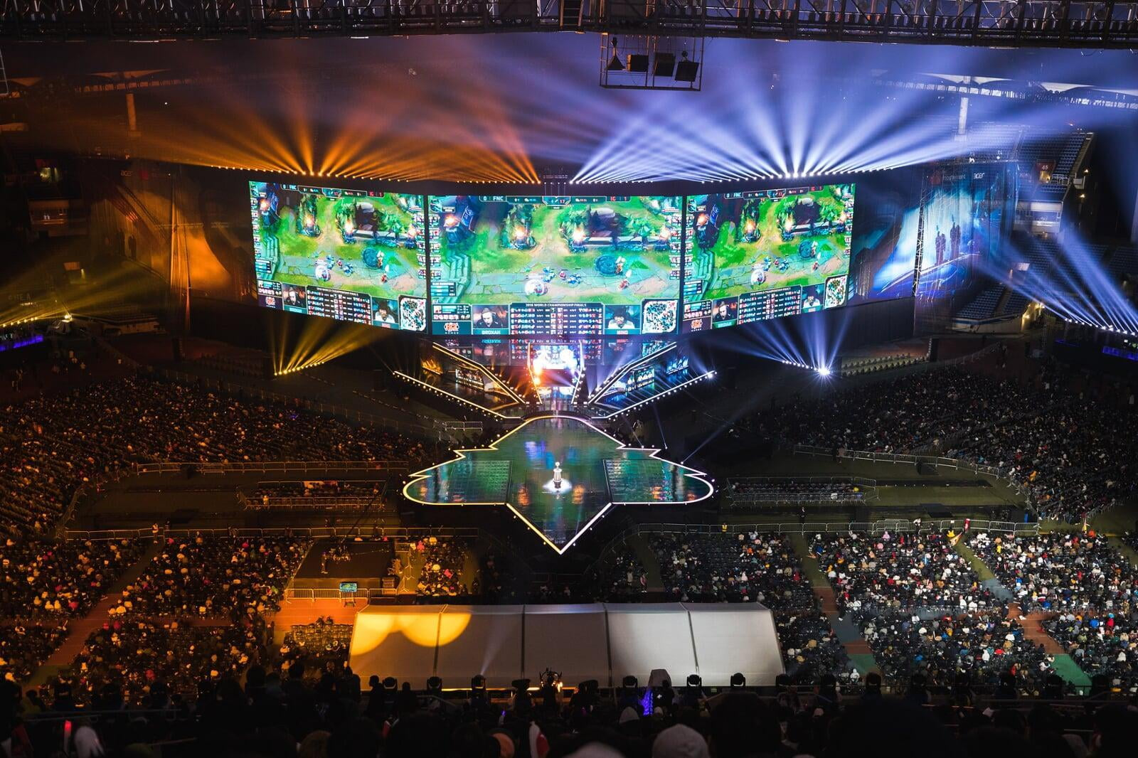 A stadium filled with screens showing live esports