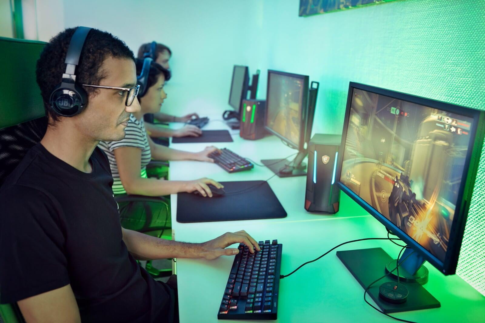 People sitting in a room gaming on computers