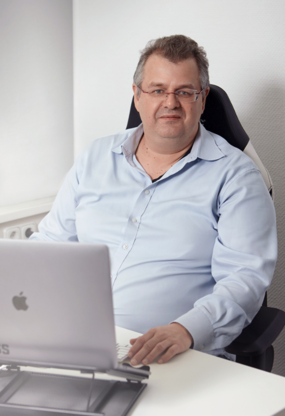 Image of a man with a computer
