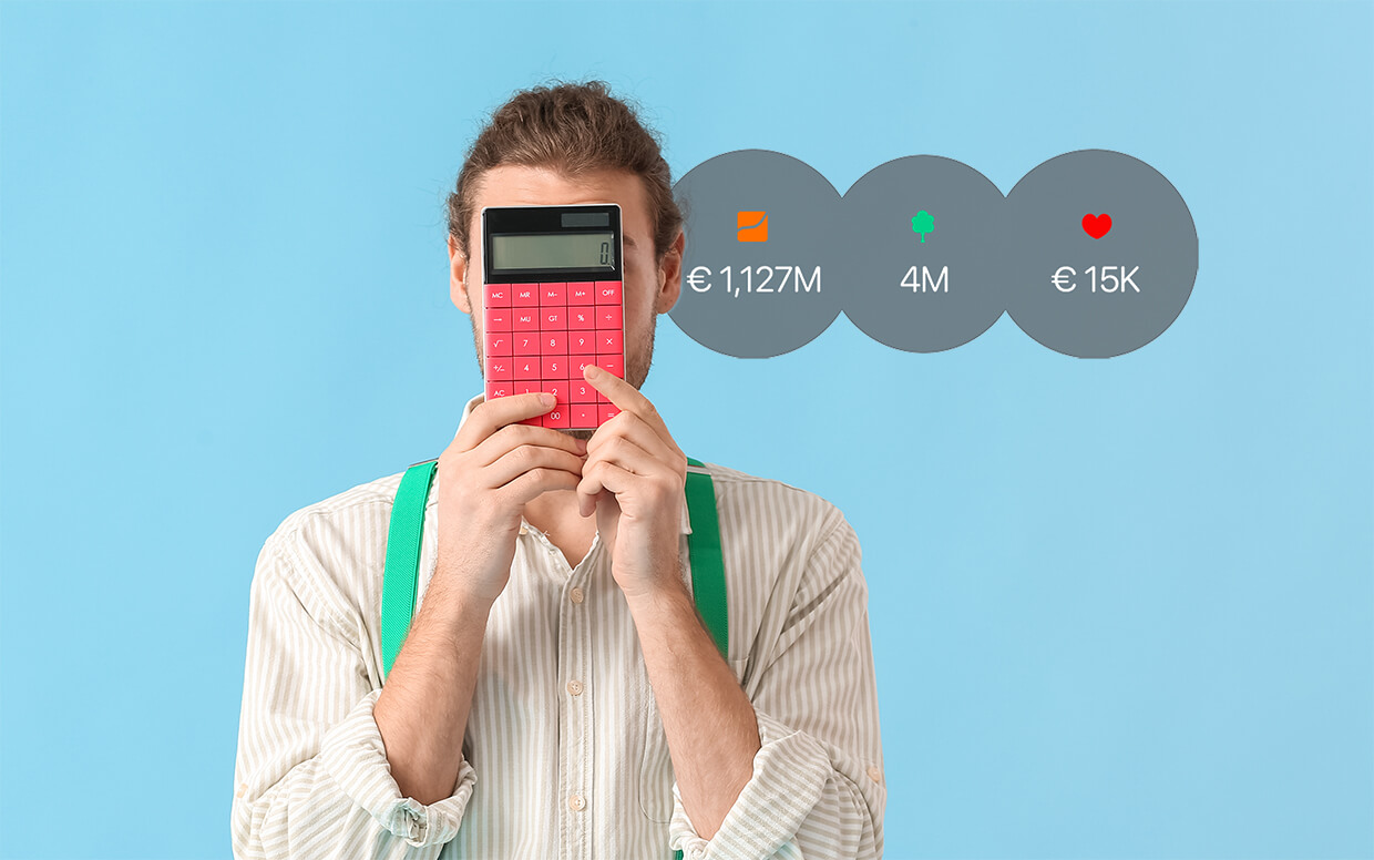 Man holding a calculator with app dashboard on the background