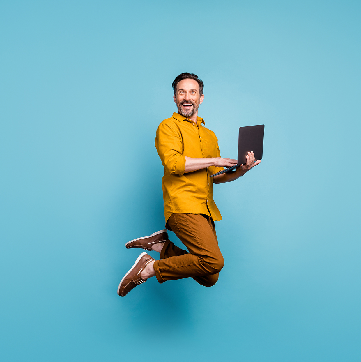 Man jumping with laptop