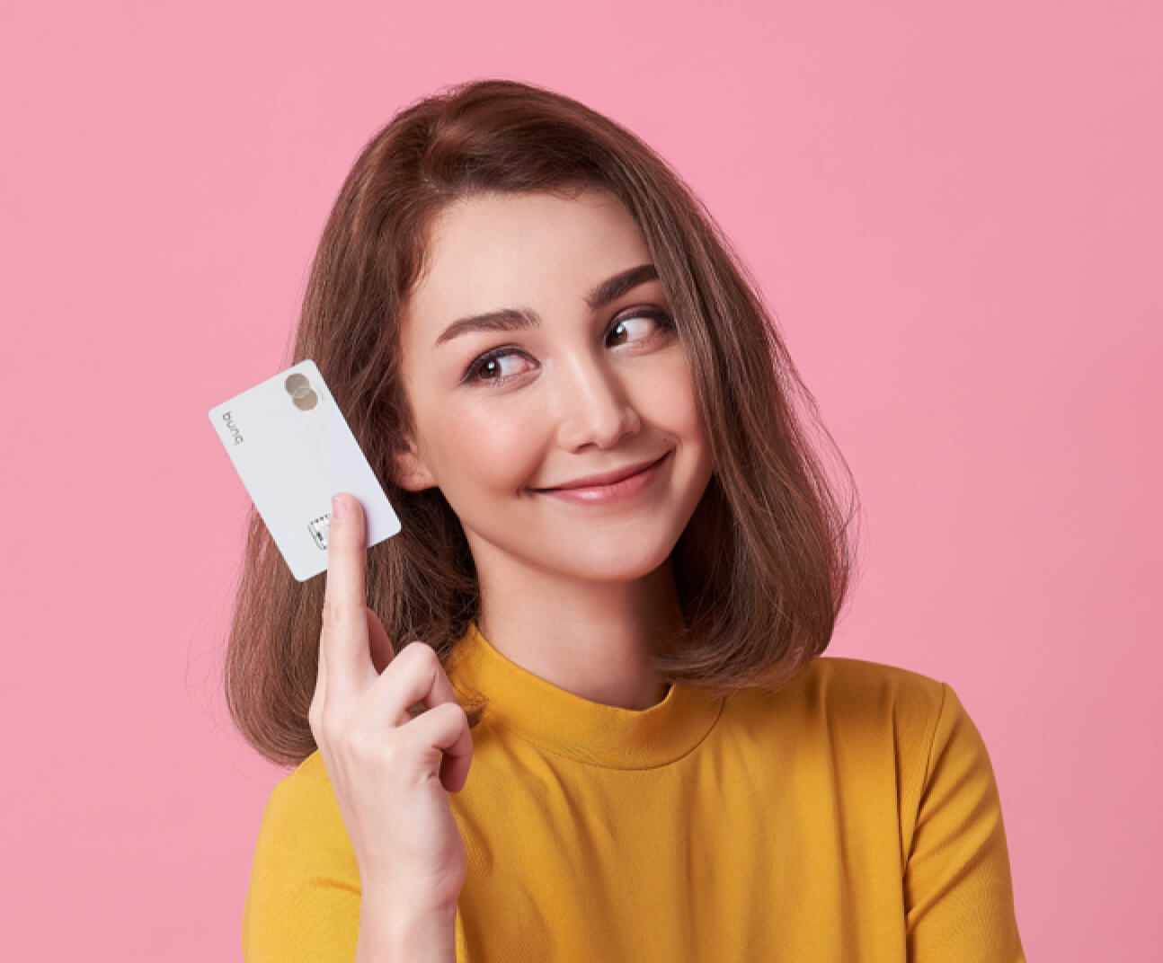 Woman holding a Metal Card