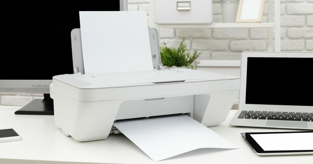 Shining white printer on modern office desk