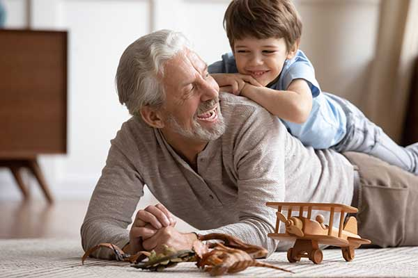 Kid playing with an old man