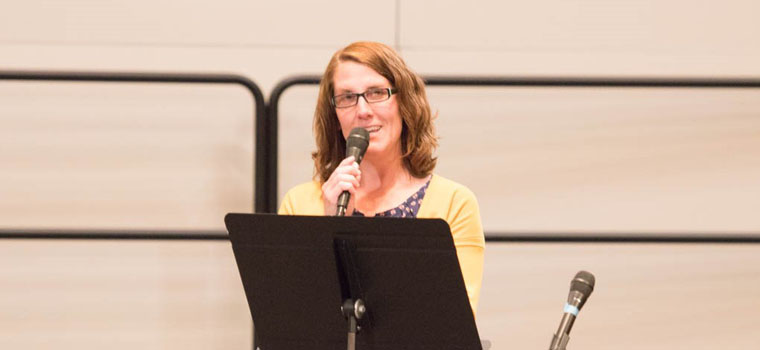 Laura Moberg testifies during the service.