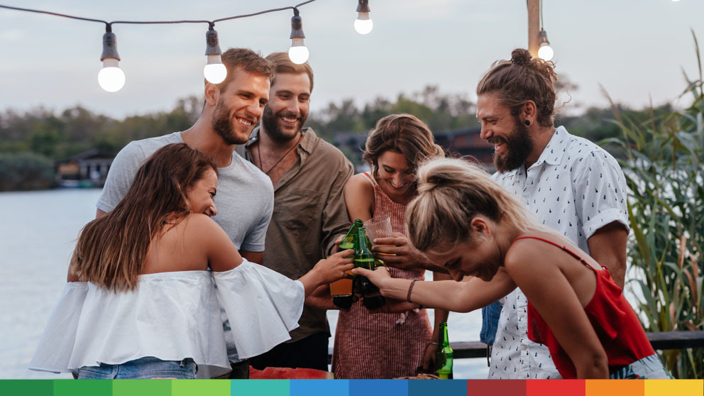 Group of people celebrating with drinks