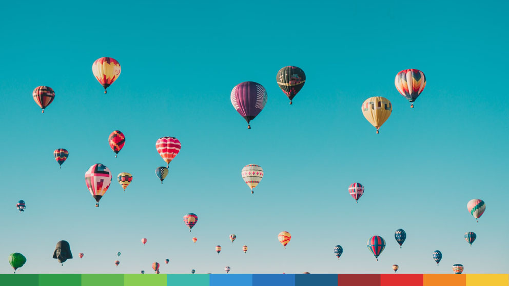 Blue sky full of colorful hot air balloons