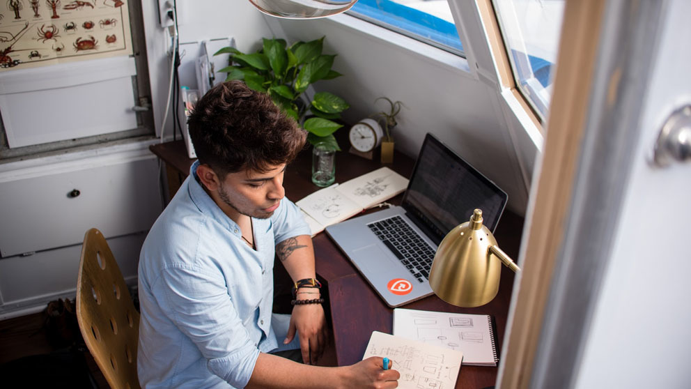 Man working behind his desk at home