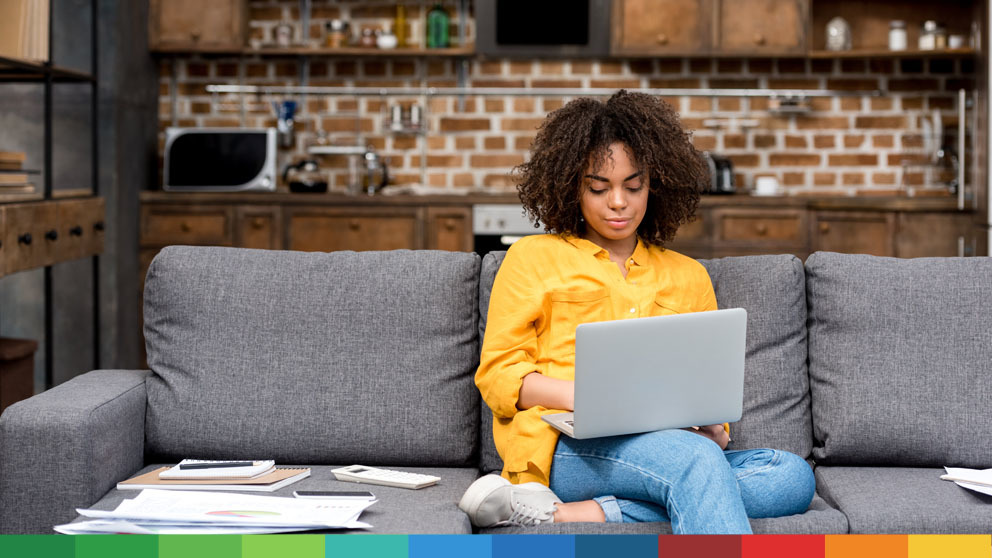 Woman sitting on the couch working on her laptop