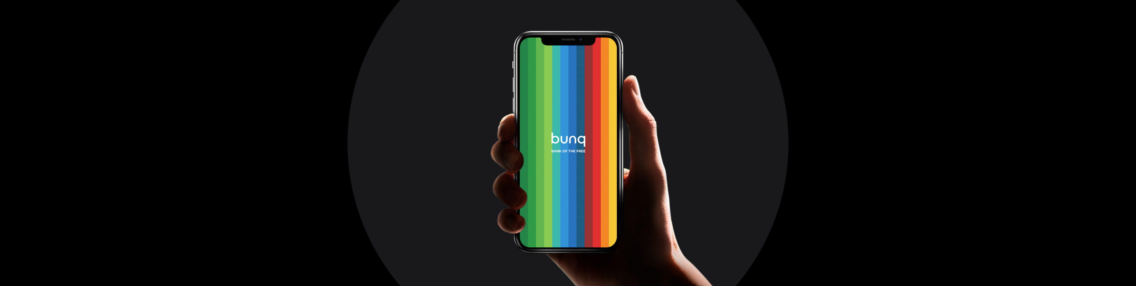 Hand holding a phone with the bunq app