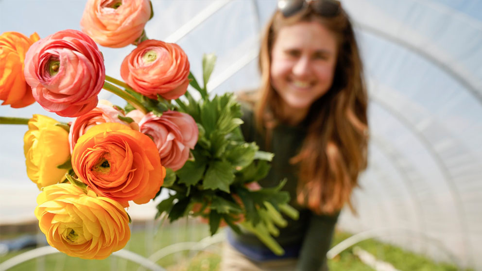 Smiling woman holding flowers