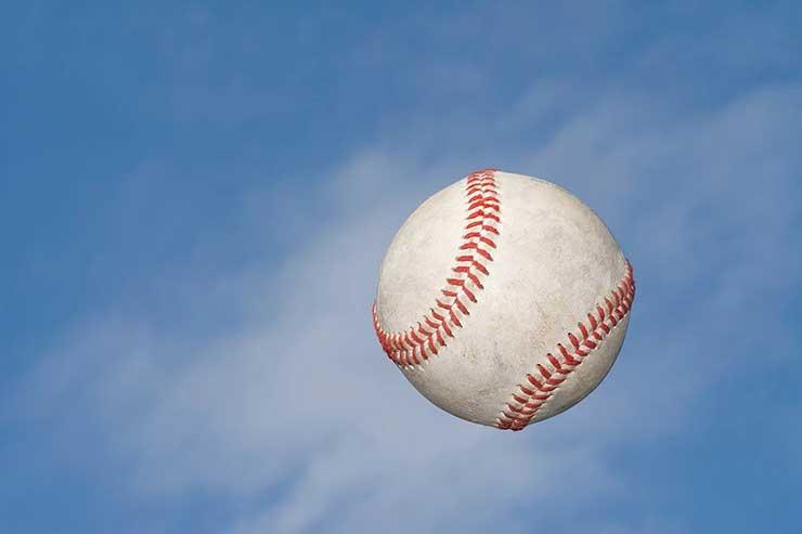 Baseball flying in air