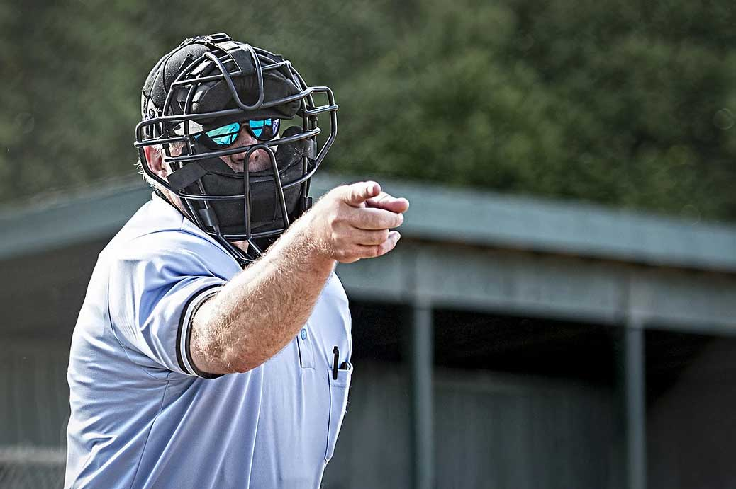 Ump pointing during officiating a baseball game