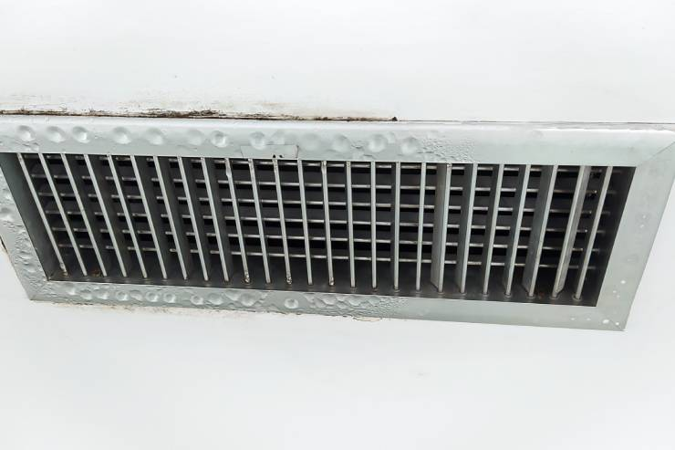 an air vent is shown with condensation