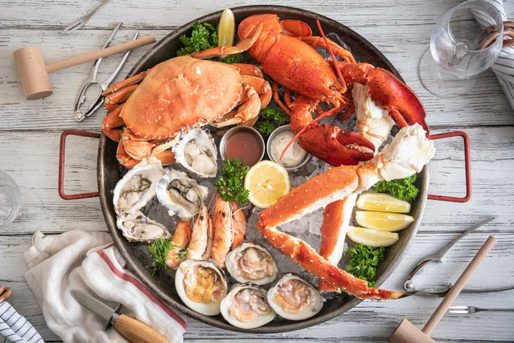 Seafood medley with lobster, crab, oysters, and shrimp